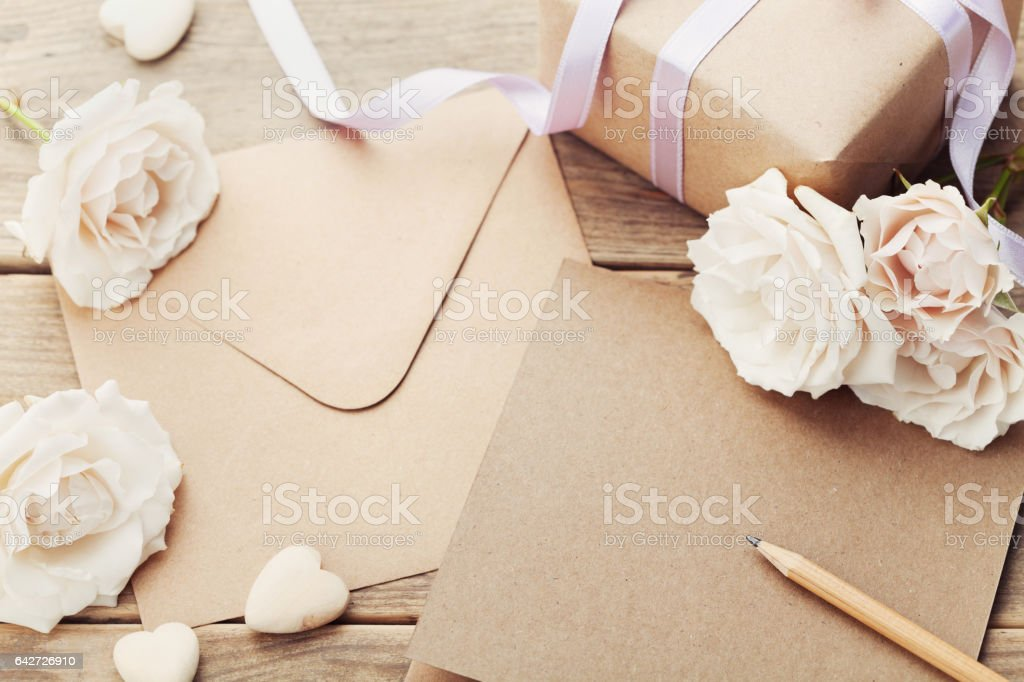 Envelope or letter, gift, paper card and roses. Greeting concept. stock photo