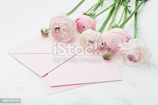 680461500 istock photo Envelope or letter, paper card and pink ranunculus flowers. Greeting on Mother or Woman Day. 680464154