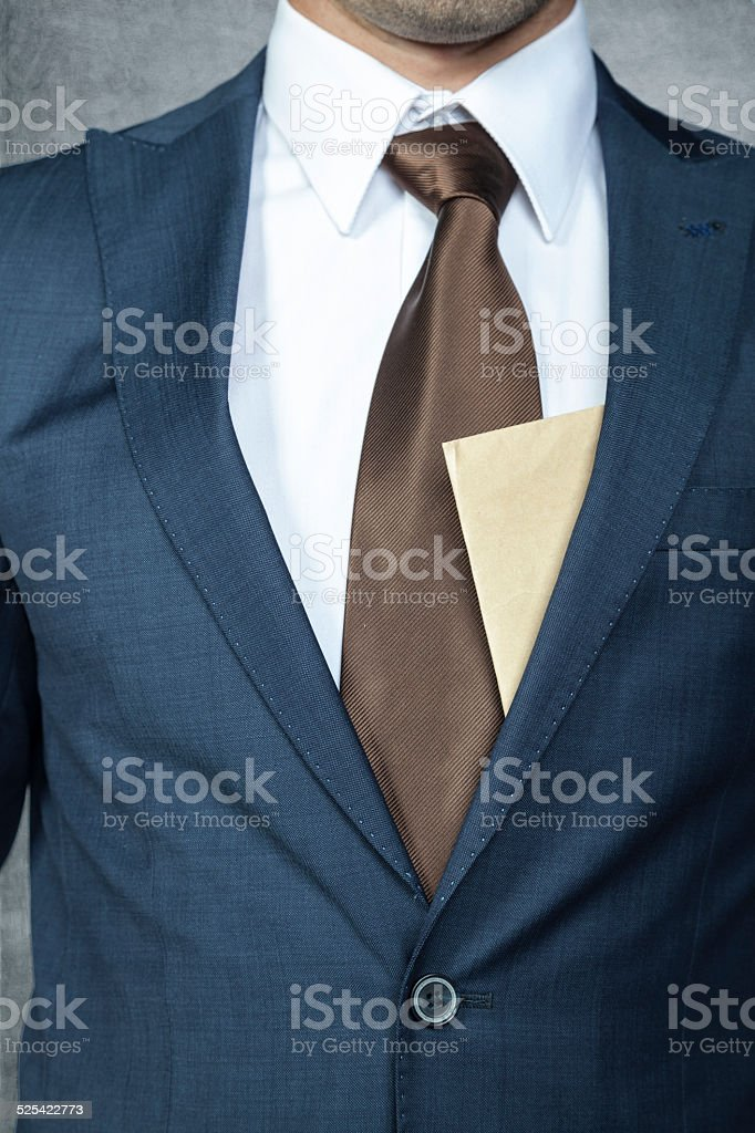 envelope sticking out from behind the suit stock photo
