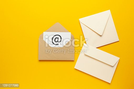 istock Envelope with e-mail symbol on yellow background, concept of corporate communication and marketing mailings 1251277050