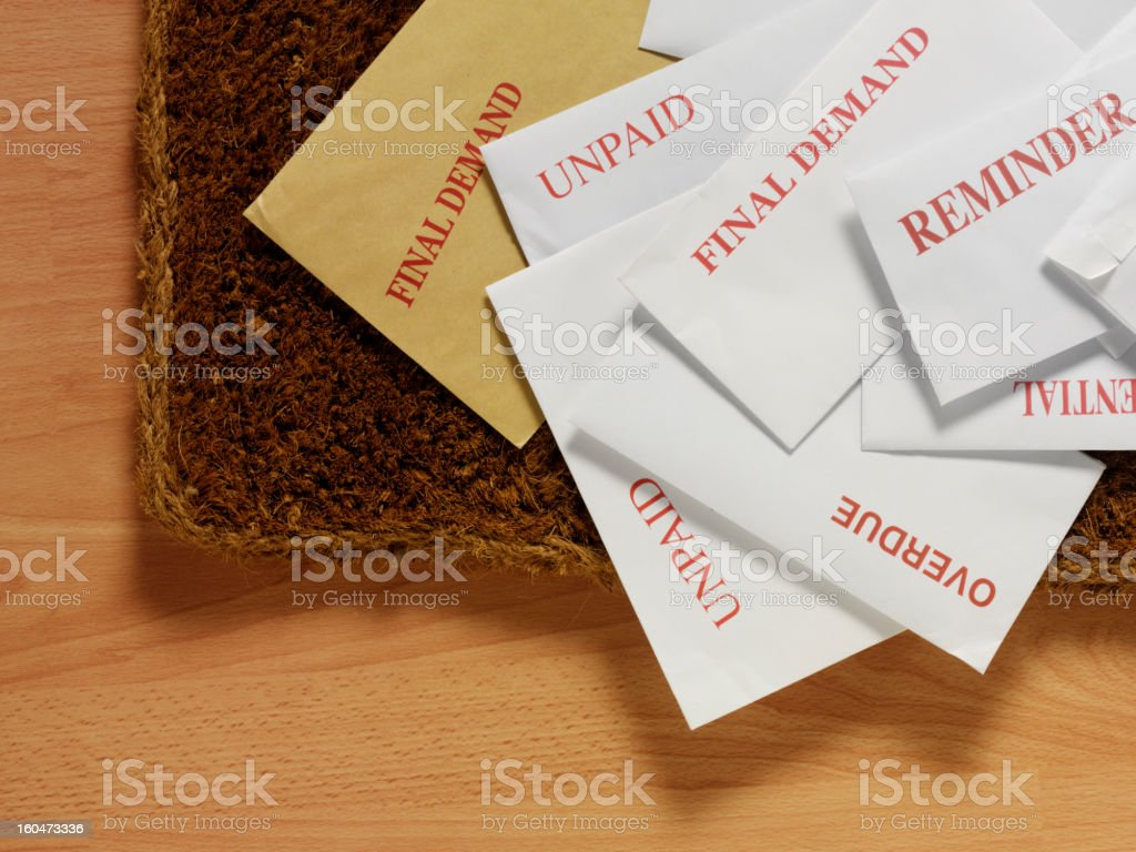 Envelopes and Bills on the Doormat royalty-free stock photo