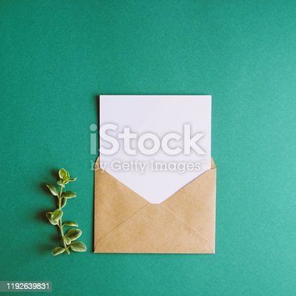 istock Envelopes with a white letter sheet on a green background. 1192639831