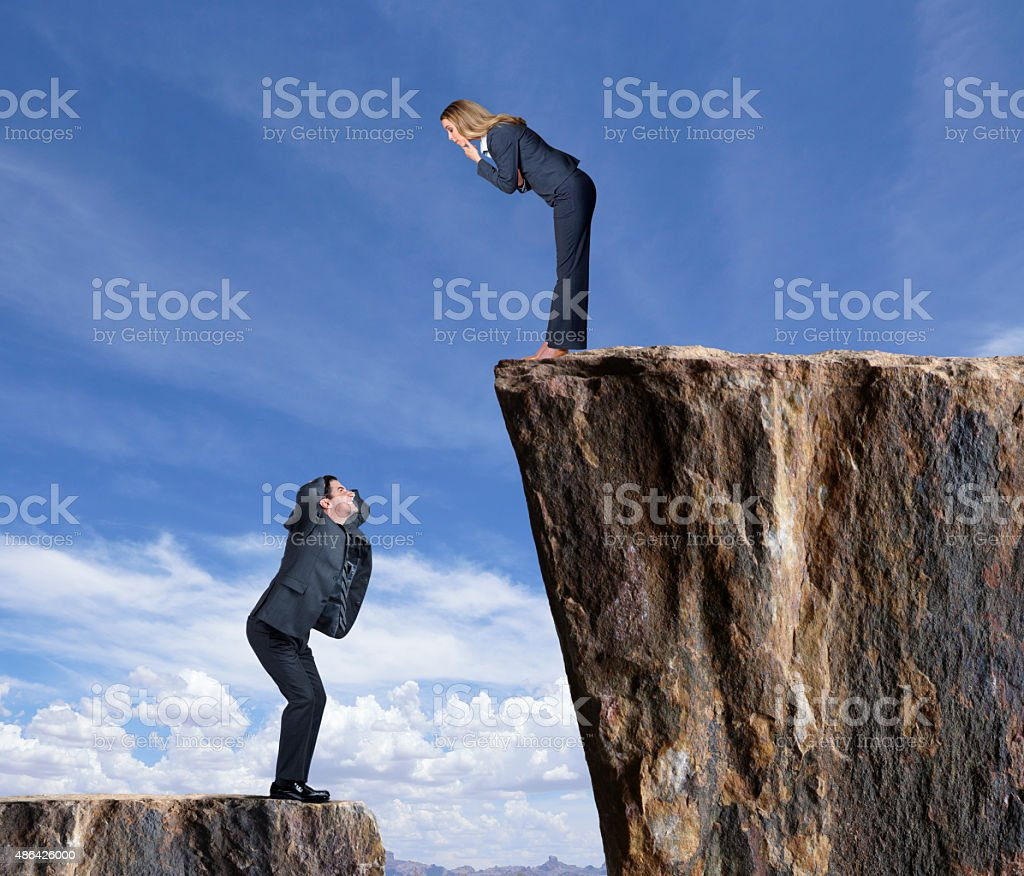 Envious Businessman Looking Up At Businesswoman stock photo