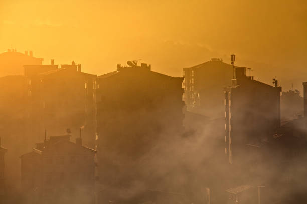environmental air pollution concept of smog and cityscape stock photo