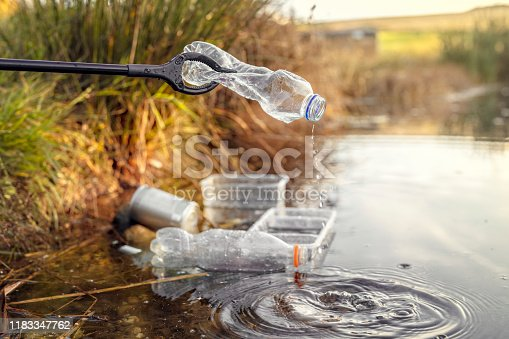 Environmental conservation and pollution collecting garbage and trash from water