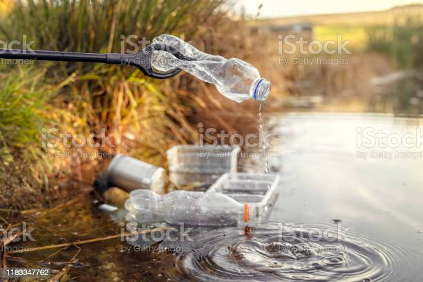 Photo of Environmental conservation collecting garbage and trash from water