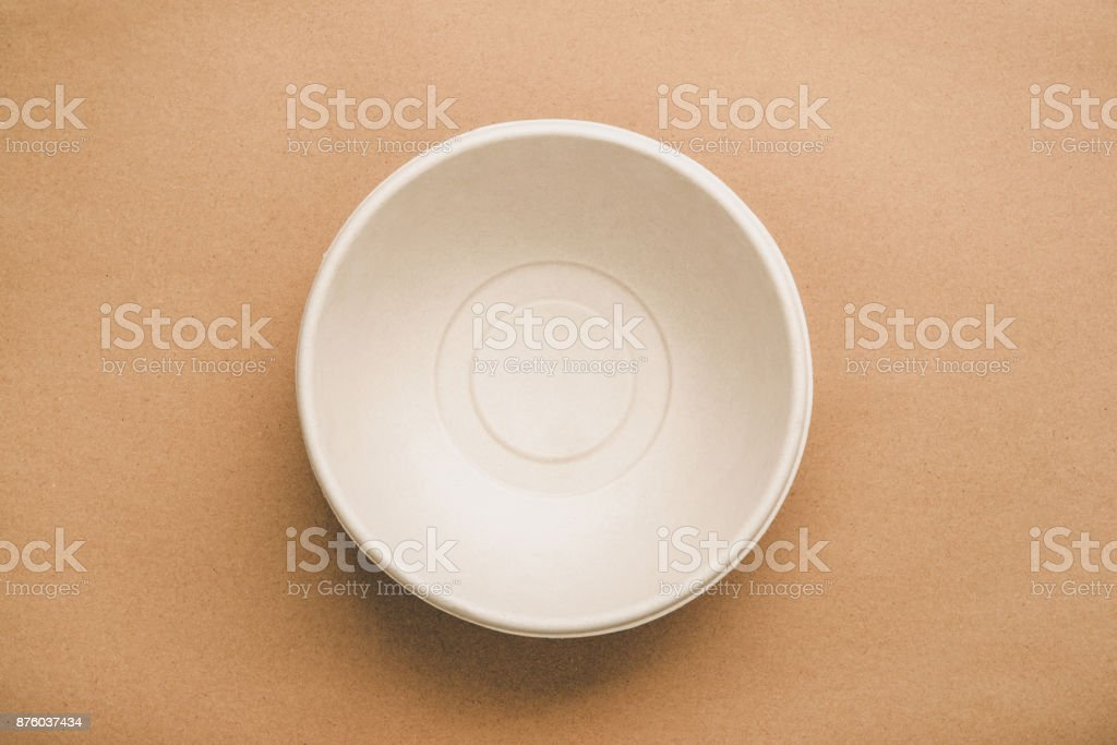 Environmental eco friendly natural compostable food container round shape bowl on recycled brown paper stock photo