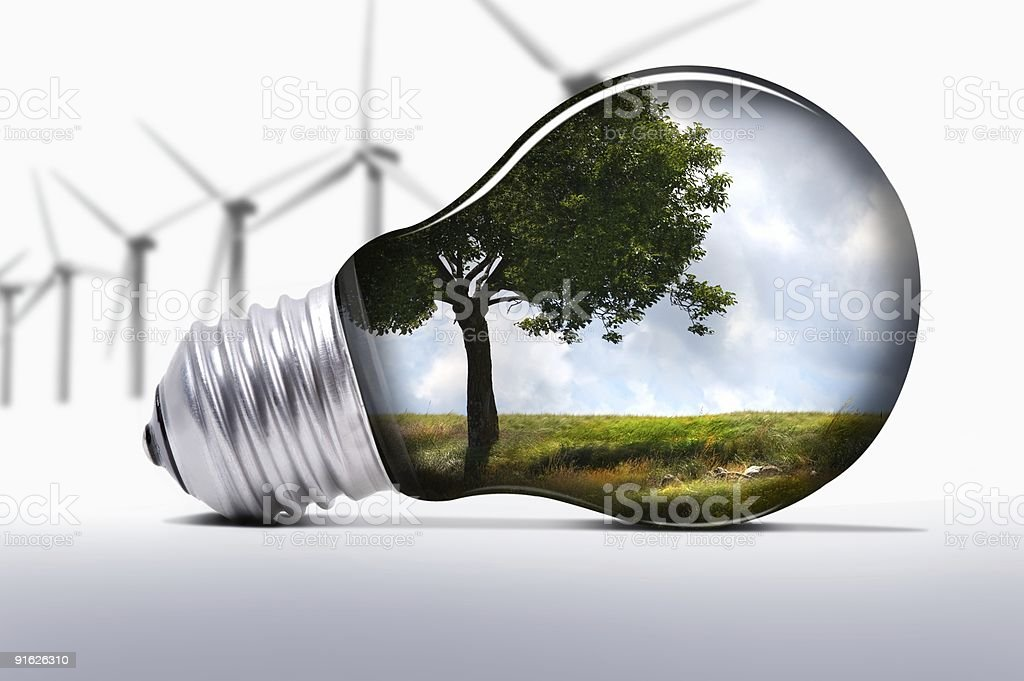 Environmental graphic with turbines and light bulb stock photo
