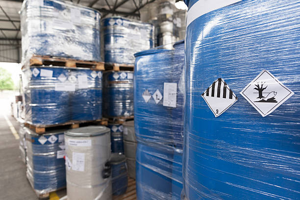 Environmental hazard barrels Waste barrels with hazard warning symbols in the warehouse hazardous chemicals stock pictures, royalty-free photos & images