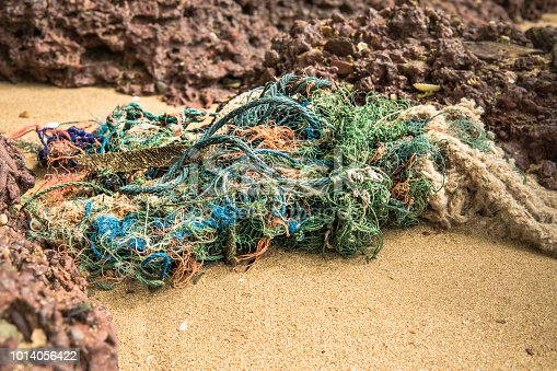 Discarded fishing net and line have been washed up on the beach at Ko Lanta, Krabi, Thailand.  These abandoned or obsolete items become dangerous garbage, polluting the Ocean, referred to as 'Ghost Nets.'  Ghost Nets are responsible for the deaths of huge amounts of Marine Life every year, through entanglement and consumption.