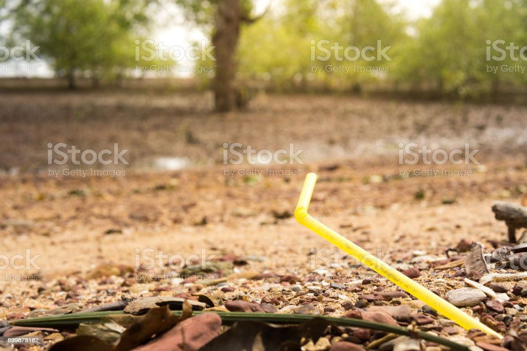 Environmental Issue: Plastic straw in the Ocean stock photo