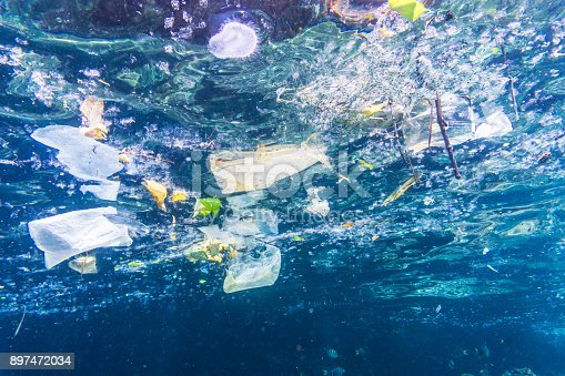 Plastic bags, bottles and cups float in the Ocean.  Seemingly harmless, they represent the massive environmental issue that is Global Ocean Pollution.  Plastic in the Ocean is said to be one of the largest threats to our ocean ecosystems.  Over 8 million tonnes is dumped in the Ocean every year.  Discarded, abandoned or obsolete items which become dangerous garbage, is responsible for the deaths of huge amounts of Marine Life every year, through entanglement and consumption.  The location here is Phi Phi Islands, Krabi, Thailand.