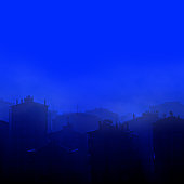 High angle view of silhouetted buildings of smoky cityscape in winter night time in Istanbul