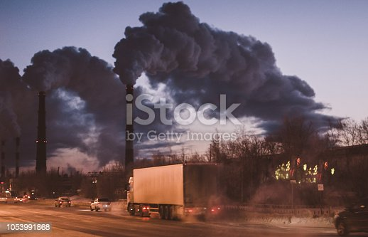 Environmental pollution in the city, the smoke from the pipes of the machines of Gaza