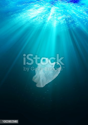istock environmental protection concept. plastic bag pollution in ocean 1002852580