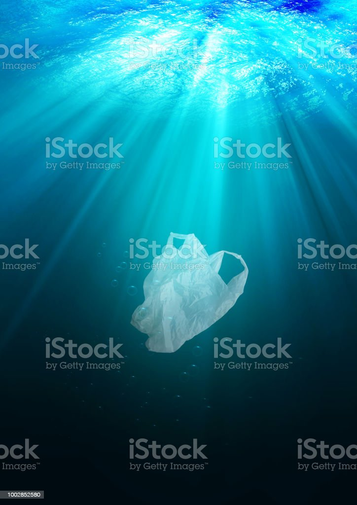 environmental protection concept. plastic bag pollution in ocean stock photo