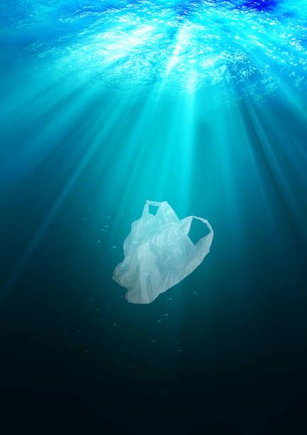 environmental protection concept. plastic bag pollution in ocean – zdjęcie