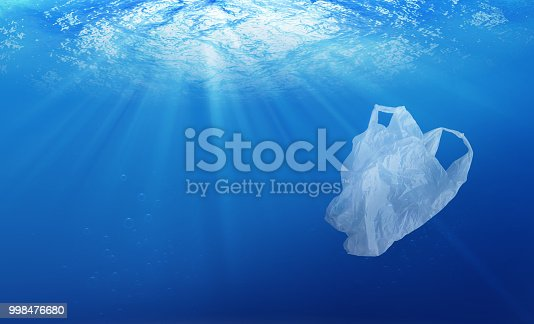 istock environmental protection concept. plastic bag pollution in ocean 998476680