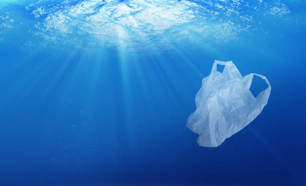 environmental protection concept. plastic bag pollution in ocean - plastic stock pictures, royalty-free photos & images