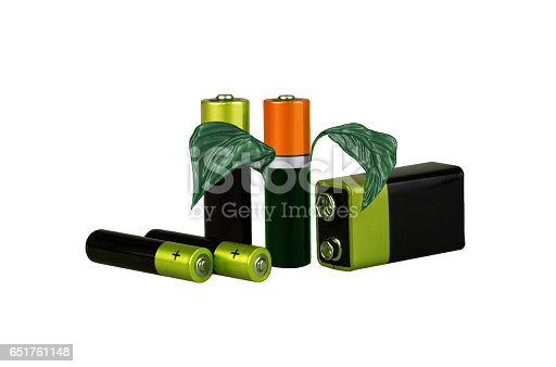 istock Environmental-friendly energy sources, batteries, on a white background, with green leaves, isolated, montage 651761148