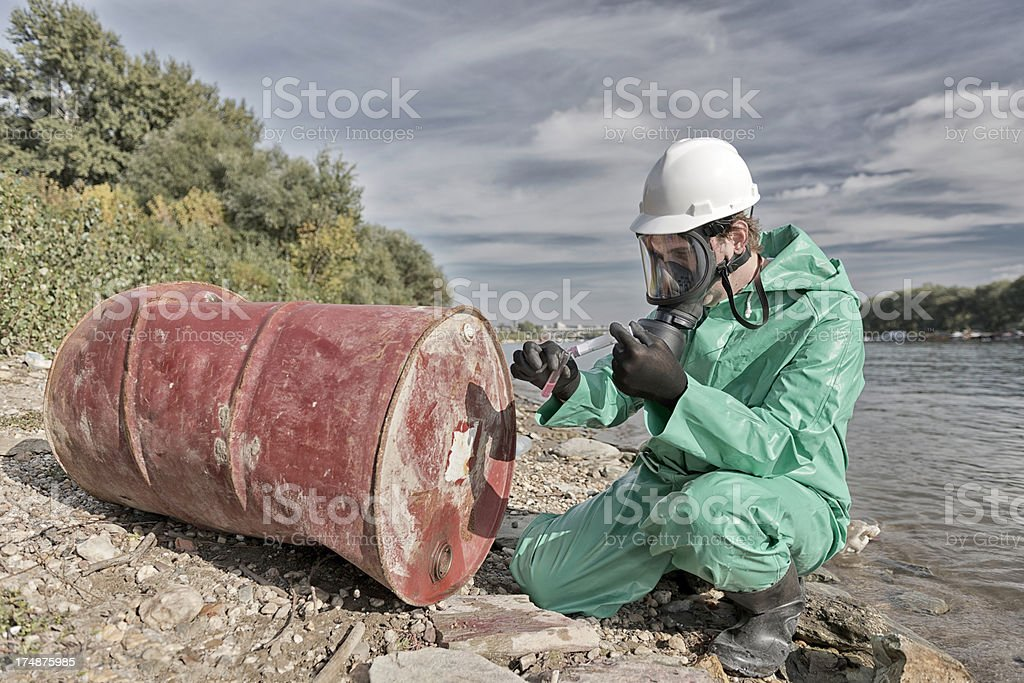 Environmentalist taking sample royalty-free stock photo
