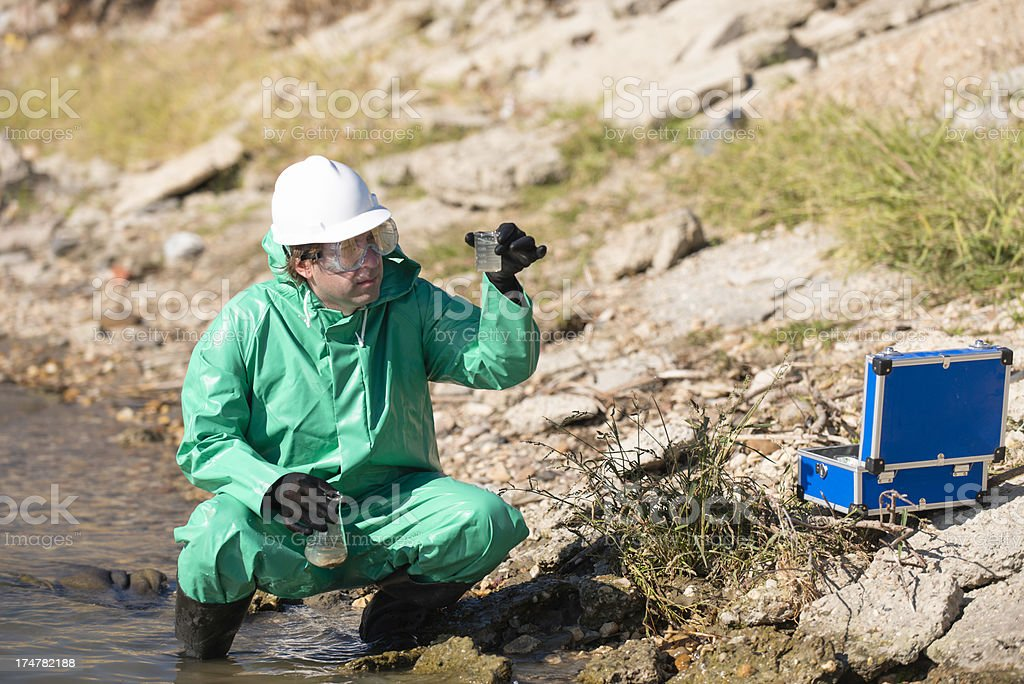 Environmentalist with samples od polluted water stock photo