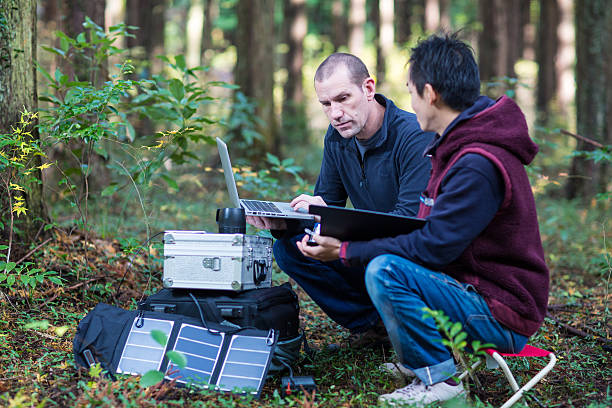 Environmentalists monitor the forest with a solar powered field laboratory stock photo