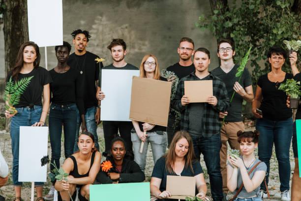 environmentalists protesting for the environment - greve imagens e fotografias de stock