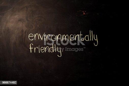 istock TEXT Environmentally Friendly against black backdrop - Illustration 966674482