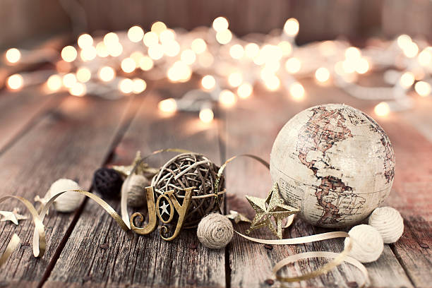 environmentally friendly christmas decorations on old wood background - vintage ornaments stock photos and pictures