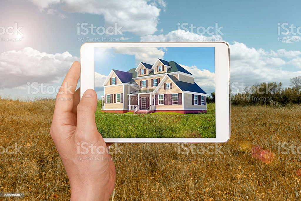 Envisioning a new home to build with digital tablet stock photo