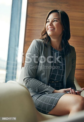 Shot of a happy young businesswoman sitting in an office chair