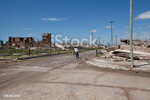 Carhue, Argentina - 18th october 2018: Woman observes the ruins of Villa Epecuen, province of Buenos Aires, Argentina. The village was flooded by the lake of the same name in the 1980s and recently its ruins have been exposed again as a ghost town.