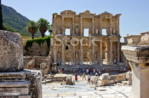 Izmir, Turkey - July 15, 2020: Tourists in Ephesus ruins and the Library of Celsus view, there are ancient Roman buildings in Ephesus, Anatolia, now part of Selçuk, Turkey. Selçuk is popular historical district of İzmir in the Turkey.