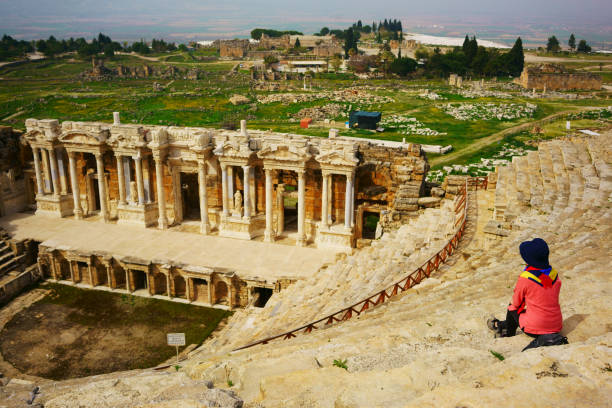 Ephesus theatre, Turkey A traveler sits at the Ephesus Theater, Turkey ephesus stock pictures, royalty-free photos & images