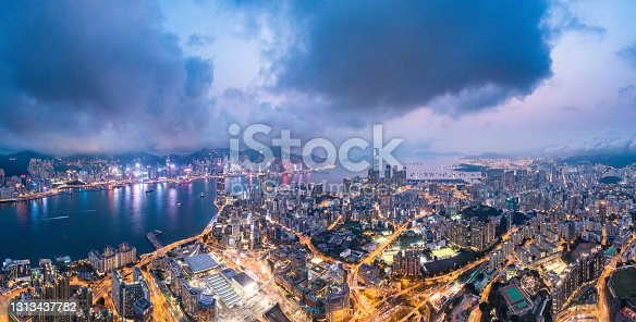 istock Epic aerial view of night scene of Victoria Harbour, Hong Kong 1313437782