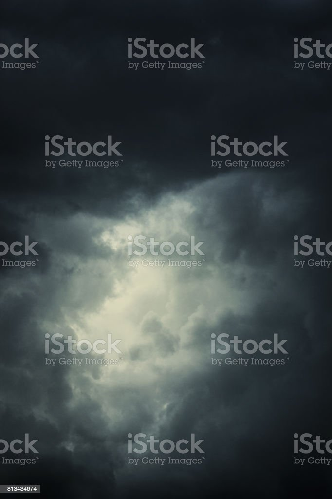 epic clouds with bright spot in the middle stock photo