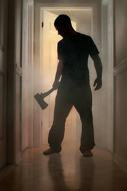 Epic concept with man holding axe inside a smoking house stock photo