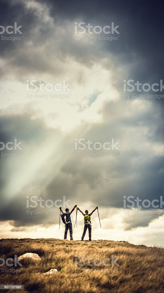 Epic photo of hikers on top of a plateau stock photo