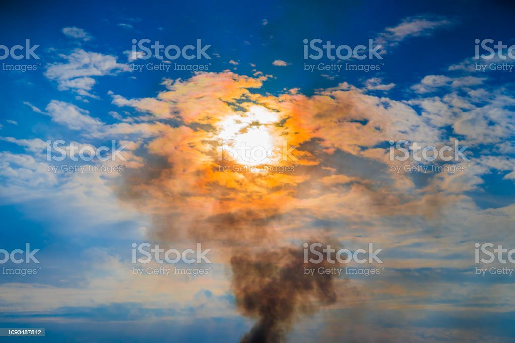 Epic sky landscape, with white blue and white clouds, shining orange...