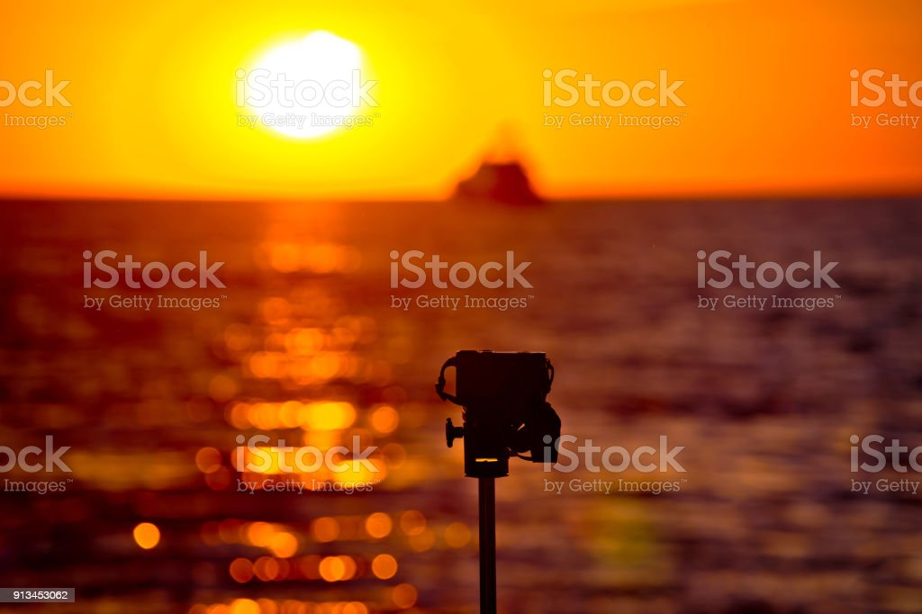 Epic Sunset Photograpgy With Dslr On Tripod Blurred Background Stock
