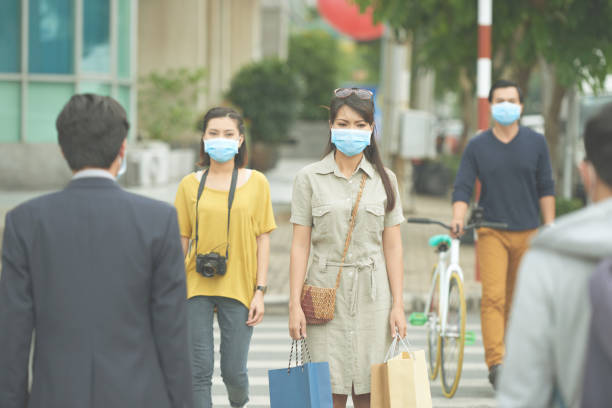 Epidemic Asian people in the street wearing protective masks epidemic stock pictures, royalty-free photos & images