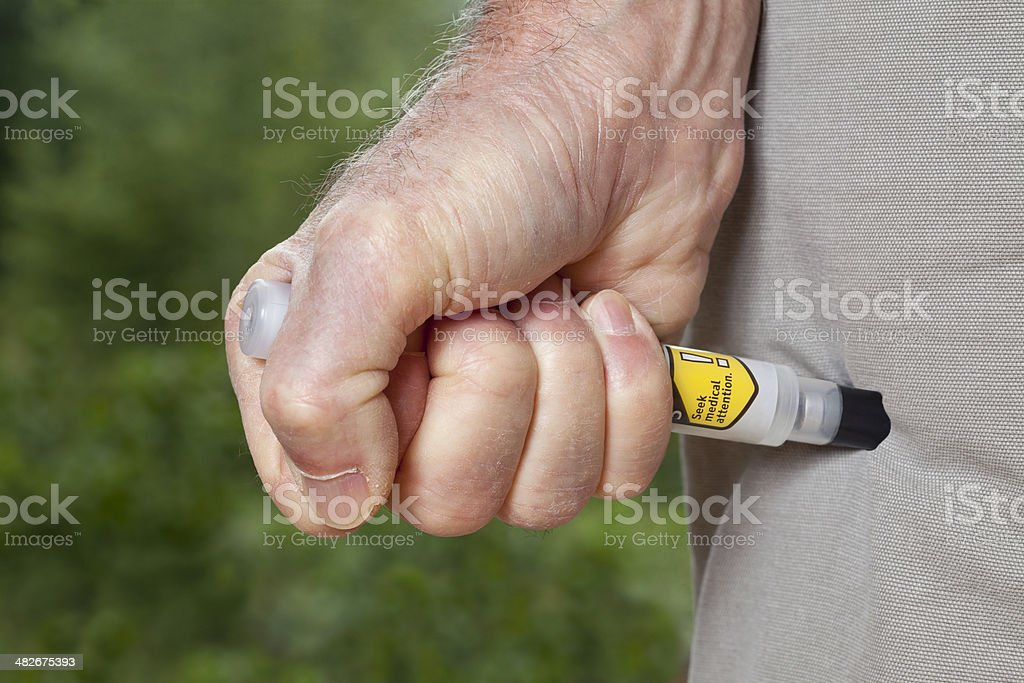 Epinephrine Injection using Auto-Injector Syringe stock photo