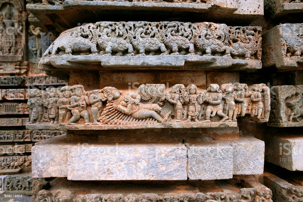Episode from Mahabharata, Bheeshma sleeping on the bed made out of arrows and waiting for Uttarayana Punya Kaala to separate the body from the soul. Carved on the Friezes at the base of temple. Kedareshwara temple, Halebidu, Karnataka, india. stock photo