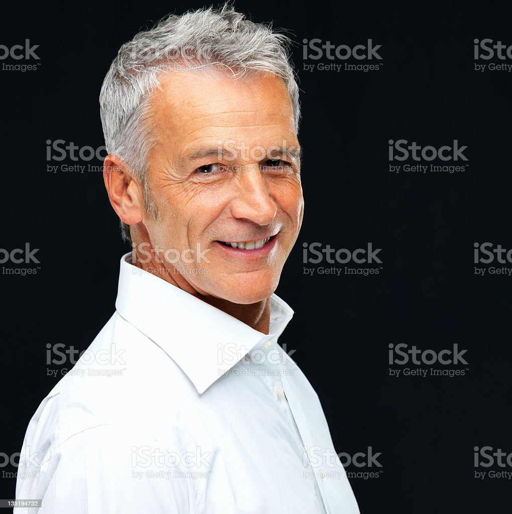 Epitomy of a successful and mature man Portrait of a handsome mature man smiling while isolated on a white background 40-49 Years Stock Photo