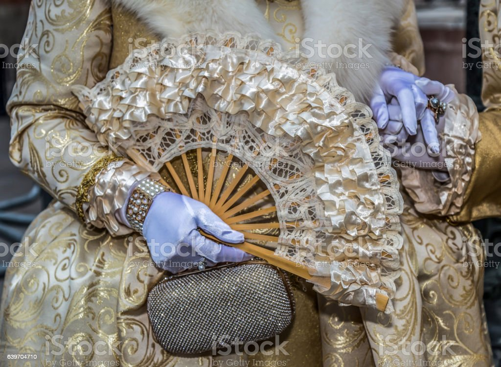 Epoque costumes at Venetian carnival.Detail stock photo