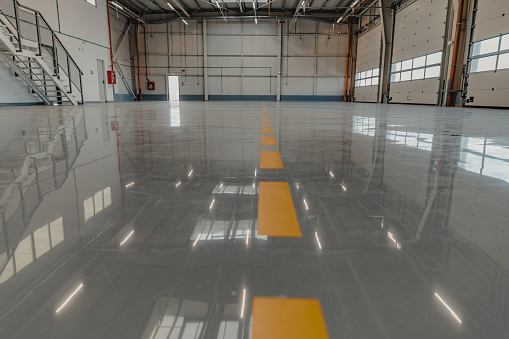 Epoxy and waxed flooring with colorful signage in car service