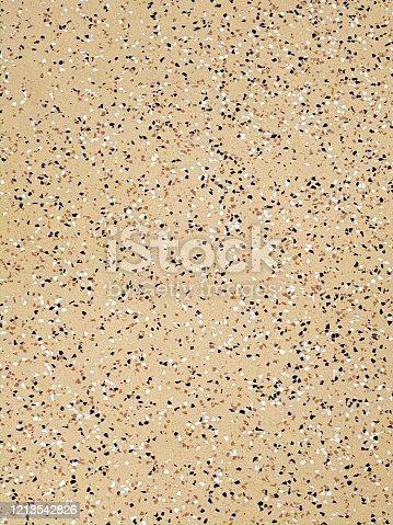 Full frame tan speckled epoxy floor background.