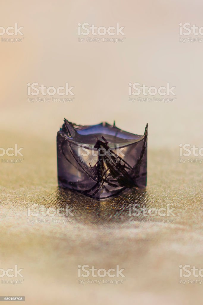 Epoxy resin crystal with peacock feather stock photo