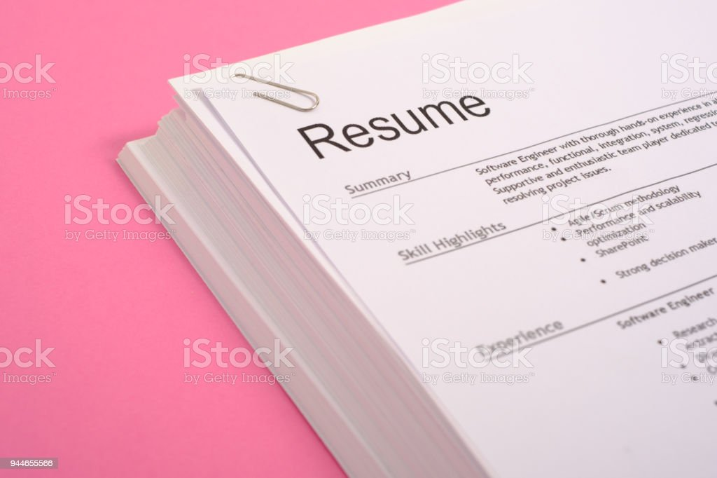 Equal opportunities career concept.Pile of cv isolated on pink background stock photo